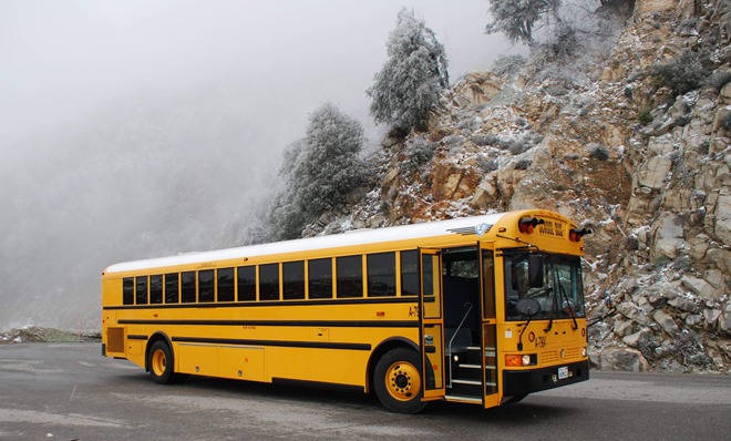 School bus in moutain fog.